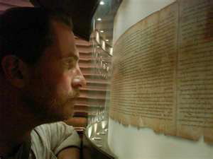 He hopped on a plane... the man is look at an original fully intact Isaiah Scroll.